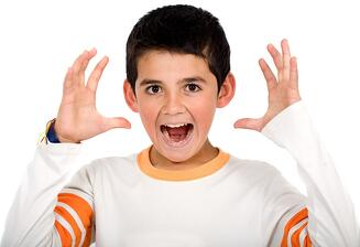 Funny child portrait – boy stressed out isolated over a white background.jpeg