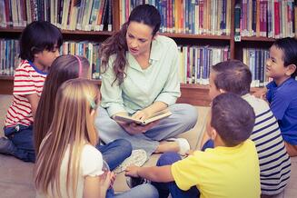 Teacher reading her pupils a story at the elementary school-3.jpeg